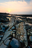 Sun setting over Kilve beach, Somerset