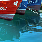 Reflections of red and blue Boats