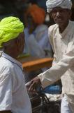 Delhites on bikes with colourfull turbans