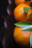 Oranges with leaves and reflections